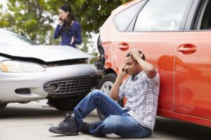 Male Driver Making Phone Call After Car Accident